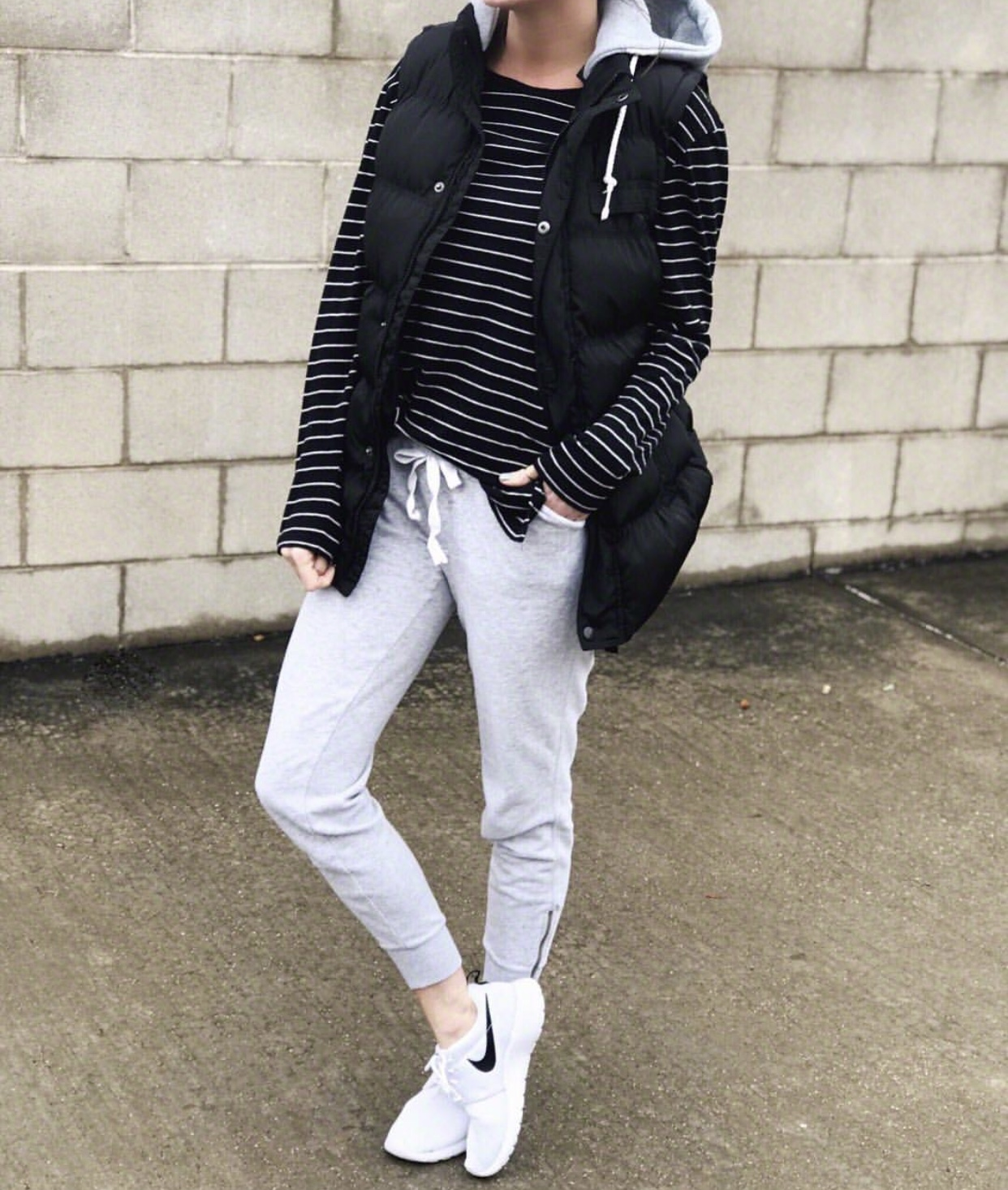Casual style, tee, puffer vest, and joggers